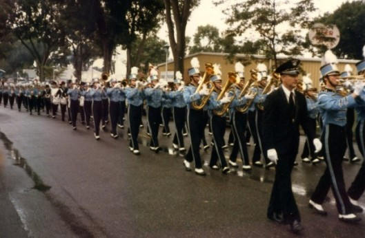 Mr. Dufault leading the Marching Jays in a parade. I'm not sure of the year, but it looks like it might be the State Fair parade. That is the style of uniform I wore from 1990-1993, but I think this might be slightly earlier than that.