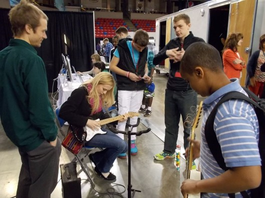 I'm glad Jen brought guitars--that was a definite draw for our arts booth. Minneapolis musician and former Mankato resident Matt Marka (left) provided some good advice to students.