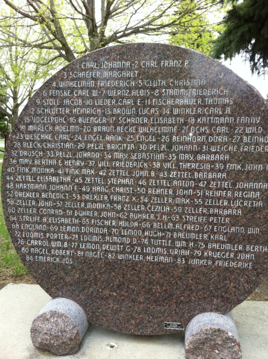 The back of the memorial. Not all of those killed have gravestones. If you go to the cemetery, you might see just a small marker with a number. The numbers correlate to the names listed here.