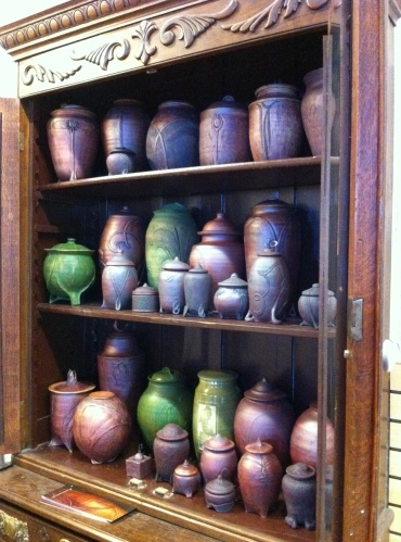 Michelle's urns are beautifully displayed. The variety of glazes give them all a different tone and feel. In person, some of the reddish urns actually look like they're made of cedar. But they are all clay.