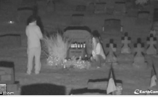 This couple was visiting Andy Warhol's grave at 9 p.m. Saturday, Sept. 14. They spent several minutes at the grave and took many photos. When the walked into the camera frame while I was watching, it scared the crap out of me!