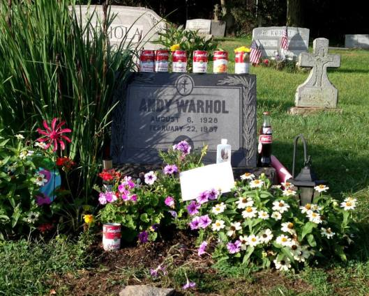Photo courtesy of Conversations with Andy. His grave has become a shrine for the hundreds of fans who visit each year. Artist Madelyn Roehrig has videotaped fans at the grave for almost five years and photographed the objects and notes they leave behind.