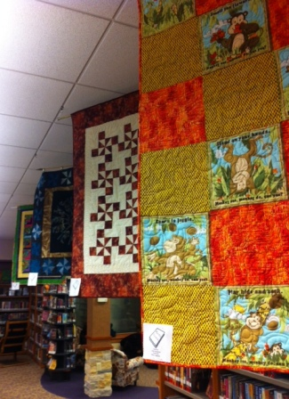 Quilts of all sizes abounded in the library. Each quilt related to a book. The variety of quilts and skill of the quilters amazed me.