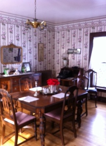 The dining room with historically accurate wallpaper.
