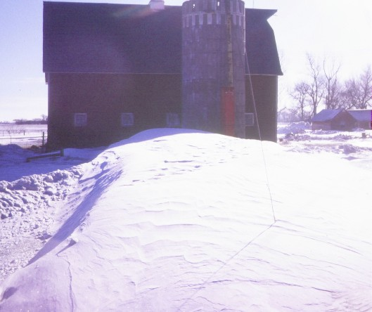 Drifted snow on the farm, c. 1970.
