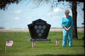 Photo from the Associated Press (Jesse Trelstad). Lillian Johnson visits relatives buried at the Lower Wild Rice and Red River Cemetery near Wild Rice, N.D.