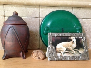 Our shrine to Kahlil on the mantel. A favorite picture, his favorite toy, the urn, and a little whippet figurine.