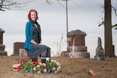 My author photo by Steven Pottenger. I love this photo so much, and am so grateful to my friend Steven for taking it. We went to a small cemetery outside of Eagle Lake, Minnesota, in late fall.