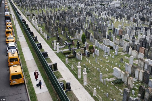 Wow, cemeteries aren't this packed around here in Minnesota! This must pose a challenge to the gravedigger and maintenance workers. Photo courtesy The Associated Press.