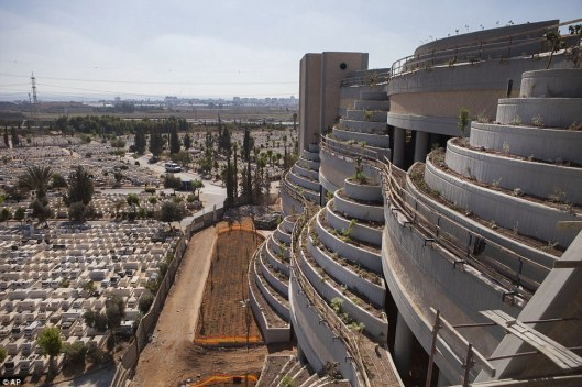 Kind of looks like a parking ramp, doesn't it? How they are solving the lack of cemetery space in Israel. This is in Yarkon Cemetery outside of Tel Aviv. Photo courtesy of the Associated Press.